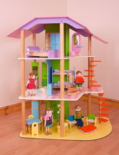 An amazing wooden doll's house that's packed with features on no less than three levels! The downstairs living space features lots of brightly coloured furniture, while up the spiral stairs you'll discover bunk beds for the kids, a bathroom and top floor suite for the parents! With so much fun under one roof, this is a dream play home for your little one to enjoy year after year. Ages 3 years and up. 41 play pieces. Dolls sold seperately. http://shop.bigjigstoys.co.uk/p/large-dolls-house