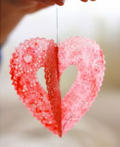 Melted Wax Doily Hearts tutorial by Aunt Peaches. This Valentine's Day craft uses wax from scented candles.