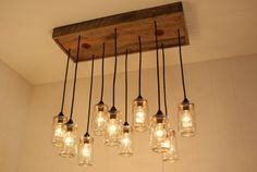 Love this idea to replace the contractor lights over the dining area, I think it would look great up against the brick wall.