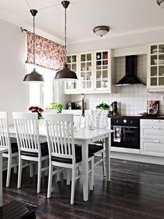 Dark floor, white cabinets