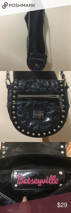 """Betseyville cross body Black and blue animal print with silver hardware. Black trim. Silver chain with black shoulder pad cross body strap. Inside lined in betseyville fabric and has 1 zippered pocket and 2 slip pockets. Outside has 1 zippered pocket and Chet. 8""""T 8"""" W 19""""strap Betseyville  Bags Crossbody Bags"""