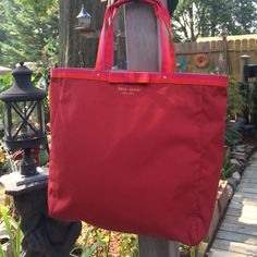 ♠️Red, Pink & orange Kate Spade tote bag♠️ Red Kate Spade tote bag! Super roomy and free of stains! Looks brand new! Smoke free! Zippers shut and has a zipper pocket inside. Handles have extra support and keeps the material clean. Used for about a week. Price firm and no trades kate spade Bags Shoulder Bags