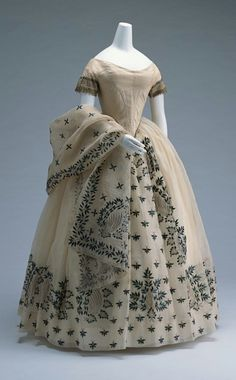 Circa 1850 gown decorated with beetle wings.