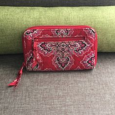 Red Vera Bradley wallet Pretty red wallet. Has a couple of small flaws but not noticeable from afar and still has plenty of life left! Six card slots an ID window and a slot for cash. Vera Bradley Accessories