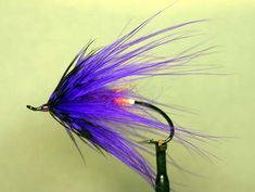 Devil's Brother - This is also a well known pattern by steelhead fishing author Rick Kustich of Grand Island, New York.  Hook: Up eye Atlantic salmon hook Tag: Florescent orange floss Body: Purple haze dubbing. Wing: Purple marabou wrapped as a hackle Collar: Purple guinea. Head: Purple.
