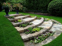 flagstone steps with built in flower beds floating steps made out of flagstone  198 Langstaff Road East Thornhill, ON L3T 3Z7 905-731-7220  Walkway Designs -- Get A Quote Follow Us on Twitter Articles on Landscaping