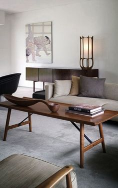 Mid Century Modern Living Room With Retro Inspired Chair, Coffee Table, And  Lamp
