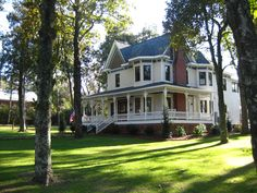 I love the huge grassy yard, old fashioned house, and wrap-around porch with a porch swing.