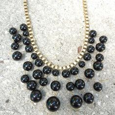 NWT black and gold necklace Brand new with tags black and gold bubble statement necklace. No trades Jewelry Necklaces