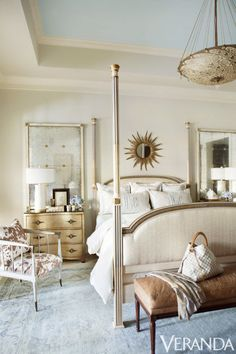 Custom bed, David Sutherland Showroom; monogrammed pillows, Leontine Linens; sunburst mirror, Tara Shaw Antiques; pendant, Fortuny through Lovelace Interiors.