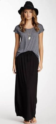 Try knotting a gray tee over the black maxi dress. Wear with leather sandals or black wedges