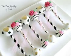 Kate Spade Inspired baby rattle cake pops created by The Cake Pop Shop. For more…