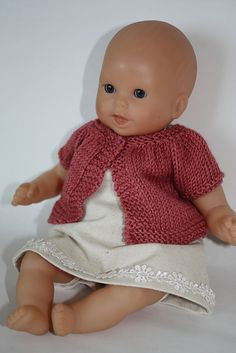 Ravelry: Little Kina pattern by Muriela - free pattern for doll sweater. Very cute, and it fit, but it seemed a bit small for the AG Bitty Baby. The larger size might be better if you don't want your little girl to need help to dress the doll.