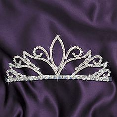 Crown Prom queens and princesses with our stunning Grandeur Tiara. The 2 1/8 high rhinestone tiara has a sturdy metal frame and 2 side combs to hold it in place