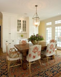 Dennison and Dampier Interior DesignSaveEmail Pattern, color, interest and charm are brought to this dining room by the slipcovers on the chairs. Can you imagine this room without them?