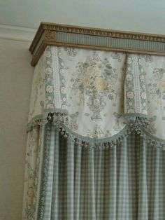 traditional scalloped valance with bells.  This treatment works well for fabrics that are fairly stiff, because there are no gathers or folds. And, it is good for showcasing a centered motif like this floral bouquet. Message DesignNashville for quotes on any custom draperies. We sketch and make our own patterns for your space. (shipping to you too.)