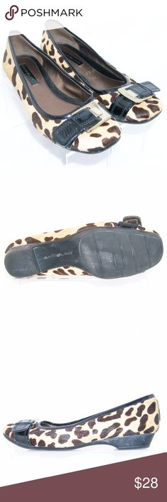 """Bandolino 'Holden' pony hair cheetah wedge 7.5M These Bandolino shoes featuers a round toe, leather cheetah print upper, balance man made, buckle on vamp, pony hair, patent lining, rubber sole, 3 1/8"""" width, and a 1"""" block heel. Slightly worn upper, inner, insole, heel, and sole. Bandolino Shoes Wedges"""