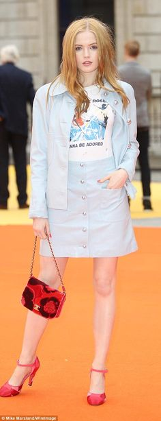 Cool and casual: Actress Florence Pugh slipped into a floral print maxidres, while Ellie Bamber opted for a pale denim ensemble