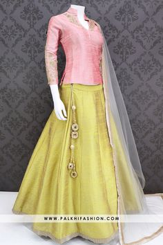 Palkhifashion pastel yellow pure silk lehenga highlighted with elegant work.This lehenga comes with light yellow long jacket blouse accompanied with contrast soft net dupatta. Lengha Blouse Designs, Choli Designs, Fancy Blouse Designs, Stylish Dress Designs, Blouse Neck Designs, Stylish Dresses, Tight Dresses, Indian Gowns Dresses, Indian Fashion Dresses