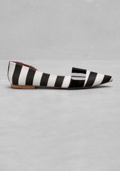 Sleek, chic, and easy to wear, these pointed flats feature a striped textile upper and a transparent TPU embellishment for a modern twist.