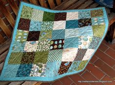squares with narrow border Small blue and green quilt.