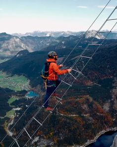 """Captured by adventure photographer Alexander Ladanivskyy, these insane panorama-ladder stairs lie 700 meters above the abyss. LEARN MORE > # Adventure Travel Videos Would you climb Austria's """"Ladder to Heaven""""? Road Trip Adventure, Adventure Couple, Nature Adventure, Adventure Time, Beach Adventure, Adventure Bucket List, Wanderlust Travel, Travel Qoutes, Travel Photographie"""