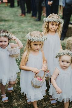 The sweetest #flowergirls in #babiesbreath crowns   Rustic farm wedding by I Got You Babe