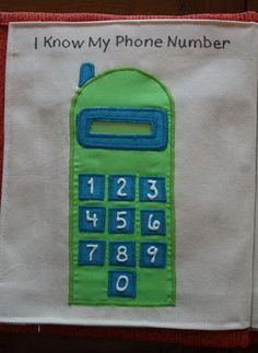 This fun little phone has a spot up top to insert the piece of paper with the child's phone number to learn. The puffy numbers on the key pad make it fun to dial up their number. http://hative.com/quiet-book-ideas-for-kids/
