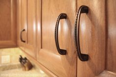 Decorative handle on rich cherry cabinets with a flat panel and rounded framing. Dream home with a dream kitchen.  Visit https://www.zelmarkitchendesigns.com for more design ideas.