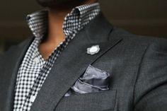 suit: checkered black and white shirt, dark grey jacket