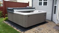 Here is a Master Spas Michael Phelps Legend Series LSX900 installed on a paver patio.