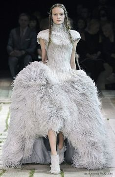 Some of our favorite looks from Alexander McQueen's Spring/Summer 2011 ready-to-wear collection. An exotic bird of a dress #alexandermcqueenreadytowear