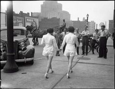 Two women showing uncovered legs in the public place for the first time. Toronto, 1937