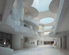 """Within the building, Christ & Gantenbein created a """"playful"""" space to contrast the more utilitarian exterior. Atrium, Contemporary Architecture, Architecture Design, Concrete Architecture, Concrete Building, Contemporary Art, Red Brick Exteriors, Glazed Brick, Lake Zurich"""