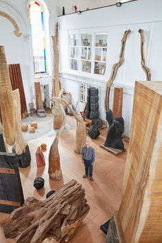 Artist David Nash pictured with some of his wooden sculptures. Photograph by Robin Friend