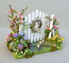 Good Sam Showcase of Miniatures: Easter & Spring Flowers - garden gate for picket fence - fairy garden or dollhouse / miniature You are in the right place about Miniature Garden japanese Here we offer Mini Fairy Garden, Fairy Garden Houses, Fairies Garden, Gnome Garden, Miniature Plants, Miniature Fairy Gardens, Miniature Dollhouse, Fairy Crafts, Garden Crafts