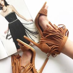 Fringe suede cognac sandals These cognac suede sandals have a woven strap across the toes and fringe ankle strap. Only worn a couple times, great condition. Express Shoes Heels