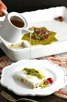 Lebanese Semolina Pudding (Layali Lubnan) includes sweet-tart cranberries, thick coconut cream, ground pistachios, and a floral-scented syrup. This vegan recipe can be whipped up quickly, then it chills in the fridge until you are ready to dig in. Lebanese Desserts, Lebanese Cuisine, Lebanese Recipes, Vegan Recipes, Cooking Recipes, Arabic Dessert, Arabic Sweets, Arabic Food, Ramadan Sweets