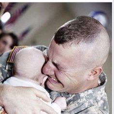 """No words needed...except maybe """"Thank you God for bringing this Warrior home..to his wife and brand new baby!"""" God Bless the USA and our Troops!"""