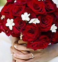 Bouquet rose rouge et fleur de jasmin blanc. Lien : mariage-original.com