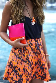 Summer look | Printed skirt, black cami and color block clutch