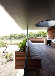 This wood and steel house by Melbourne studio Architects EAT has a huge projecting roof that shelters a first floor barbeque deck.  Named Linear House, the seaside residence provides a family holiday home on the south-west coast of Australia.
