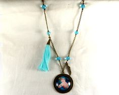 Vintage style long necklace -Retro Lady,bronze shades ,blue glass beads and glass cabochon by CapricesDeParisienne on Etsy