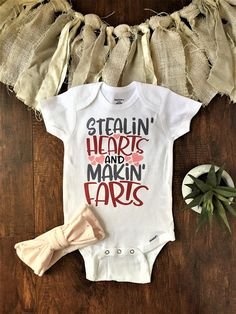 Stealin Hearts and Makin Farts Valentines Day Baby Onesie®. Funny baby shower gift! Available in short sleeve/long sleeve and with or without stretchy super soft light pink with gold polka dot headband bow! We use Gerber Onesies® and all of our products are beautifully wrapped upon