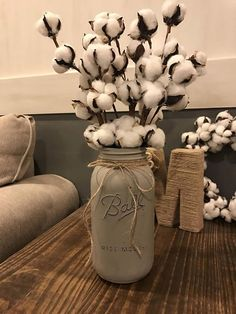 This listing is for a simple and adorable Half Gallon Painted Mason Jar with Cotton Bill Stems! Cant go wrong with some good ole cotton in the home! Perfect touch for the rustic farmhouse look :) Purchase includes the cotton stems!!!! :)  You can choose y