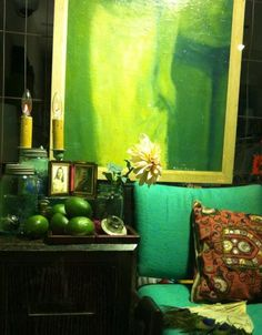 Day of the Dead. Altar. Mason jar. Scorpions. Ghostly portrait. Candle lamp. 1950's lounger. Ebonized cabinet. Limes.