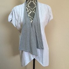 Gray open front top This is a DAVID by David Kahn top with open front. The colors are two shades of gray. Size is medium. It is in gently worn condition with no holes or stains. David Kahn Tops