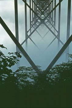 Steel girders on the underside of the New River Gorge Bridge in Fog, West Virginia by Todd Stradford