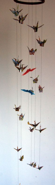Peace Cranes made from recycled pages of a London A-Z circle and protect two Butterflies. In Japanese wedding culture 'Mecho' and 'Ocho' are...