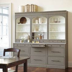 I love these china cabinets -- the matte gray color and marble insert feel both modern and traditional.